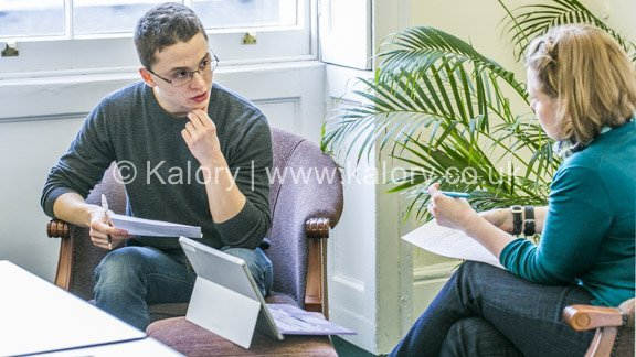 lifestyle shot of interaction between a professor and a student